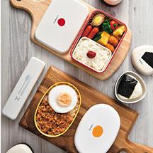 うめ、のり、まめ、たまご…お弁当に合う具材をデザインしたお弁当箱。